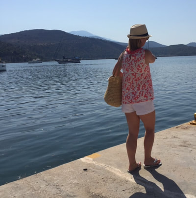 woman at harbour argostoli kefalonia