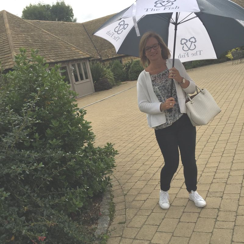 woman with umbrella at the fish hotel