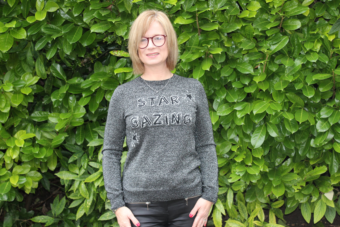 wearing star gazing jumper in black and grey