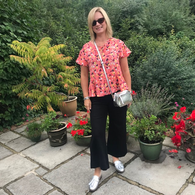 woman in garden wearing vionic shoes