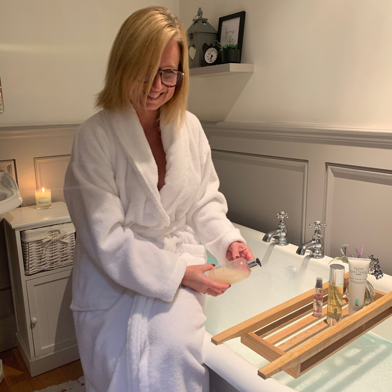 bathroom and white robe | self care box | hug in a box | b-line beauty