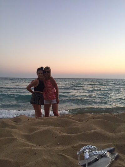 mother and daughter on beach kefalonia