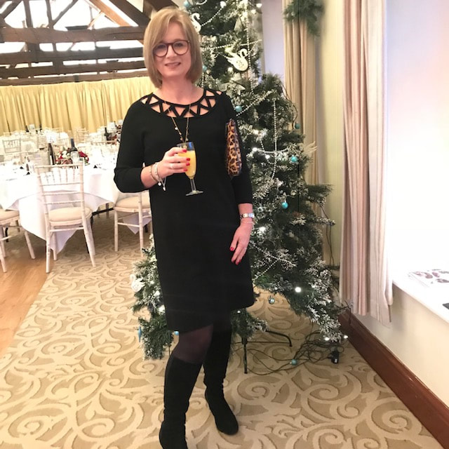 wearing a black dress from Winser London for a winter wedding