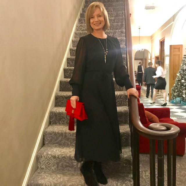 wearing a black dress from boden for a winter wedding