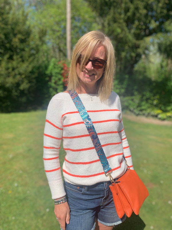 orange cross body bag from love the wendy house