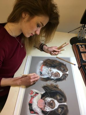 Sophie Fois artwork drawing a picture of two spaniel dogs